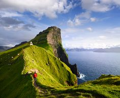 """Buy the royalty-free Stock image """"Kallur Lighthouse on Kalsoy island. Hiking on the Faroe"""" online ✓ All image rights included ✓ High resolution picture . High Resolution Picture, Faroe Islands, Lighthouse, Monument Valley, Cool Pictures, Stock Photos, Photography, Travel, Image"""