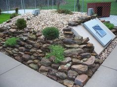 Trying to figure out a way to hide storm shelter in landscaping...maybe?