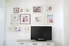 gallery wall around tv to help it blend in a little bit . . .