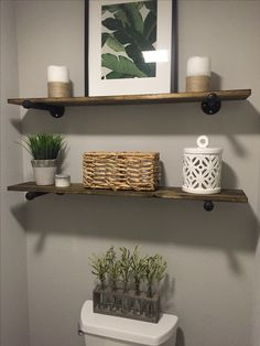 Love the simplicity of how they decorated the floating shelves