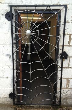 """Cool! You can get a spider web gate custom made by """"Art of Metal"""" in the UK. £480.00"""