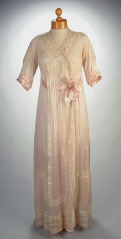 Vintage Fashion: This delicate, pink silk lace nightdress, features a fashionable high waistline. Circa 1900. Photo Credit: Aberdeen Art Gallery and Museums