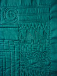teal green quilt, African collage border quilting