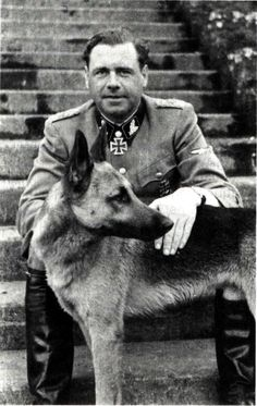 SS-Brigadeführer und Generalmajor der Waffen-SS Fritz Witt who commanded the 12th SS Panzer Division Hitlerjugend in Normandy is seen here with his German Shepard. Witt was a charismatic leader who had the deep respect of his men. Jovial in nature he was very often photographed in good spirits even when the chips were down. Even veterans who had served with him in Russia were said to have wept upon hearing the news of his death in his Normandy Bunker.