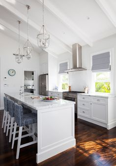 Oh my #kitchen! This space is gorgeous. From the printed stools, to the modern finishes we love this #whitekitchen