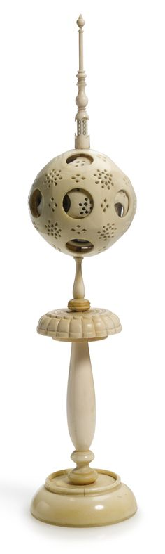 An engine-turned ivory nesting 'contrefait' sphere on stand, together with a group of five French ivory containers 19th century, the contrefait probably French  Sotheby's