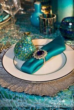 elegant table setting.. Peacock! like the teal napkin and pearl napkin ring holders... LC 072514