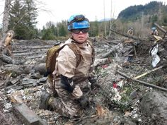 Air Force Master Sgt. Eva Mayberry of Spokane and member of the 141st Washington Air National Guard Medical Group removes debris by hand in an effort to find missing persons after a mudslide in Oso. (Photo by Spc. Matthew Sissel, 122D PAOC)