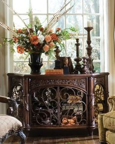 Stunning vignette on this ornately carved sideboard.
