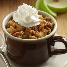A simple yet delicious easy apple crisp recipe made in microwaveable mugs with tart apples, sweet granola, brown sugar and cinnamon