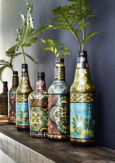 Decorated bottles are a unique and colourful way to display fresh flowers. Perfect for adding an exotic vibe to your home this summer. #home #decor #interiors