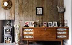 Oliver Heath's home, where the walls are clad in reclaimed larch . Photograph by Catherine Gratwick