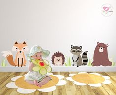 Enchanted Interiors Nursery Wall Art Woodland Animals  Create a magical setting with our Enchanted Woodland Animal premium self adhesive fabric wall art. Perfect for placing above the skirting board or around your nursery room furniture. Simply peel and stick to create an engaging setting within hours!  Included in this scene: 1 x Bear 11.78 Wide x 13.94 High 1 x Fox 25.63 Wide x 14.57 High 1 x Racoon 10.51 Wide x 12.12 High 1 x Hedgehog 4 x Grass  CUSTOM SIZES: Please contact us to discuss…