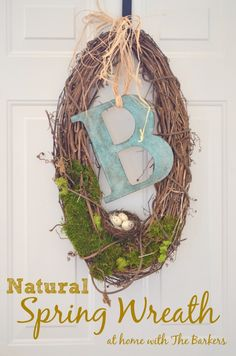 Natural Spring Monogrammed Wreath via At Home with The Barkers. I love its unique oblong shape! Pretty & Simple!