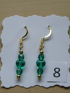Gold plated copper ear wires with a jade green heart between 2 small round crystals