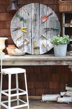 Spool top with vintage garden tools.