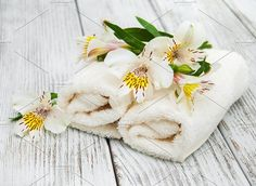 Spa towels and alstroemeria flowers . Health Photos
