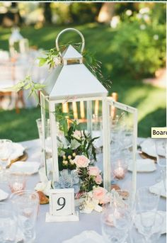 Love the little flowers and greenery with the latern