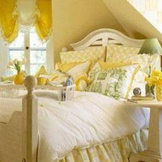 Pretty yellow bedroom decor. Nice to wake up to sunshine inside!