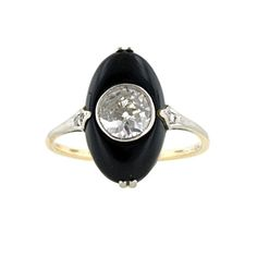 Art Deco .65 ct. Center Diamond & Onyx Ring | From a unique collection of vintage more rings at http://www.1stdibs.com/jewelry/rings/more-rings/