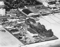 Aerial view of The Pike, Long Beach, CA, 1940. The Pike amusement center opened in 1902. It has games, rides and shops. Pacific Electric's Red Cars start running in Long Beach from Los Angeles.