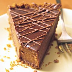 Thanksgiving dessert: Triple-Chocolate Pumpkin Pie ~ A hidden layer of bittersweet chocolate coats the graham cracker crumb crust, semisweet imparts a silken smoothness to the customary custard, and a drizzle of milk chocolate on top teases the eye -- and the appetite.