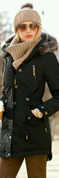 This black winter jacket looks so good with a beige hat and scarf. Credit: Inverno