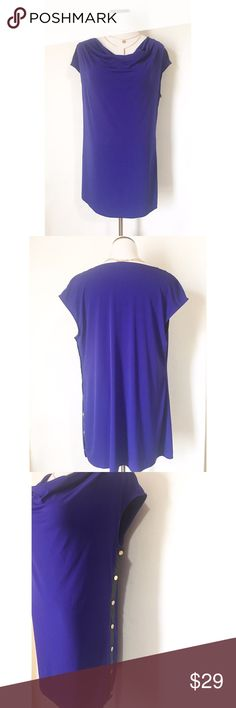 Calvin Klein draped top Gorgeous blue with a black faux leather down the side with gold buttons! Excellent condition! Size large Calvin Klein Tops Blouses