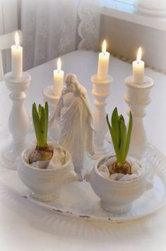 Lillies and Candles clothed in white. Remember to save my bulbs when I thin out my lillies!!