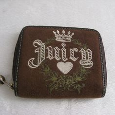 "Juicy Couture Wallet Authentic Juicy Couture Velour Wallet. Pre-owned in good condition. Corners has SCUFFS and the Metal zipper pull is TARNISHED. Sold as is! Dimensions: 4""H x 4.5""W x 1.25"" D ~❌SWAP❌TRADE ~ ✔️❤️Bundles ~✔️Smoke-free/pet-free home Juicy Couture Bags Wallets"