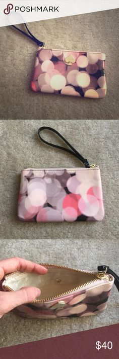 Kate spade wristlet Small wristlet, a little bigger than the biggest iPhone. Purple, pink, cream, and black in color. Zips closed. Plastic like finish which offers a nice shine. Only used once, great condition! kate spade Bags Clutches & Wristlets