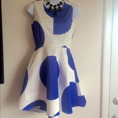 Brand new PJK Paris white with large polka dot Dress. This dress has triple lining. One is the regular white lining and one is the same as the dress pattern. This is the perfect dress for any occasion.Firm unless bundled. Thank you for understanding.  PJK paris Dresses
