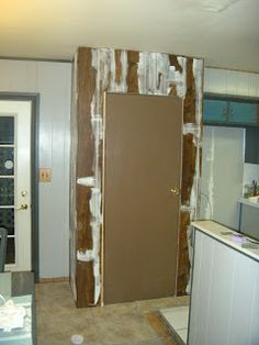 How to cover wood paneling with spackle.  Why does EVERY damn house have to have a room with the gawd-awful paneling?!?