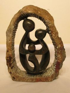 Abstract stone sculpture done by Zimbabwean Shona artist. African Masks, African Art, Animal Key Rings, Family Sculpture, Family Of Three, Stone Sculpture, Beaded Animals, African Animals, Wire Art