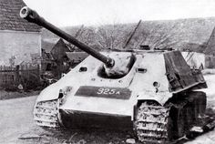 """An abandoned Jagdpanther painted in white."""