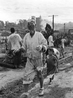 Korean war refugees in the Inchon area, coming in to the US contingent of the United Nation's Forces for aid. (Photo by Picture Post/Getty Images). 1950
