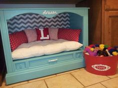 Cute dog bed made from an old TV console - love this idea!                                                                                                                                                                                 More