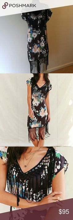 NWT Floral fringe dress This is a Silky tee dress with macram fringe trim made from vintage fabrics by our reconstruction team at Urban Renewal.  Never used. Great condition. Sold out online. Size M/L  Hit offer button! Urban Outfitters Dresses
