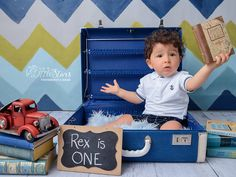A Baby is sitting in a briefcase, finding books and toys. One Year Old Baby, Baby Boy Photography, Toy Trucks, Babysitting, Briefcase, Baby Photos, Cute Kids, Toy Chest, Storage Chest