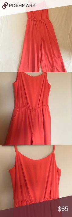 "Gianni Bini Jumpsuit NWOT Orange-ish spaghetti strap jumpsuit wig adjustable straps, concedes waist, and front pockets! Never worn but is so fun!                           Approximately 18"" bust. Gianni Bini Pants Jumpsuits & Rompers"