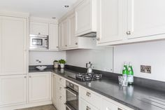 Bespoke kitchen, in Little Greene Portland Stone, with honed granite work surface