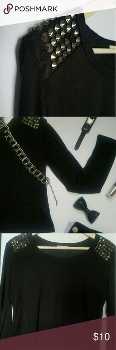 Rock Star Black Tee Ready, Set, Rock! This black tee features stud shoulder detail Waist length  100% Rayon Tops