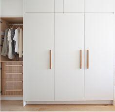 Wapping E1W: Stylish Wharf flat - Increation. Timber handles. Scandinavian contemporary wardrobe