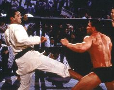 Royce Gracie vs. Ken Shamrock. Their first fight was epic. With Royce choking out Ken with his Gi. The 2nd was not too exciting, but Ken hurt Royce with a hard punch, it was declared a draw.