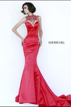 Beautiful mermaid gown with a nice train and detailed sheer neckline and plunging back. View Size Chart
