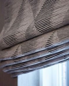 Love this fabric for a roman blind the perfect combination of texture and geometric patterns without being overbearing. #fabrics #romanblinds #windowtreatments #details #interiordetails #luxuryinteriors #luxuryhomes #interiorinspo