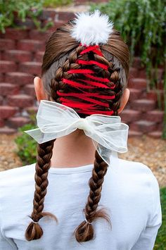 braided christmas hairstyles with white bow