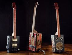 A fancy black and gold electric ammo guitar; big gas can 3 string bass, pirate chest 4 string guitar with tin resonator.