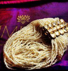 Pearl and kundan bracelet by Umrao Jewellers via Instagram
