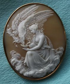 "Cameo of Sardonyx Shell, 15K setting. Circa 1860 Italy. Hebe is the goddess of youth (Roman equivalent: Juventas). She is the daughter of Zeus and Hera. Hebe was the cupbearer for the gods and goddesses of Mount Olympus, serving their nectar and ambrosia, until she was married to Herakles (Roman equivalent: Hercules); her successor was the young Trojan prince Ganymede. Another title of hers, for this reason, is ""Ganymeda."" Hebe comes from a Greek word meaning ""youth"" or ""prime of life""."
